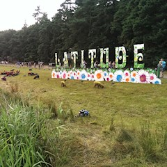 The colourful sheep by the lake at Latitude Festival