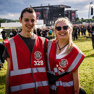 Volunteer at Download Festival - Arena volunteers with stage in background