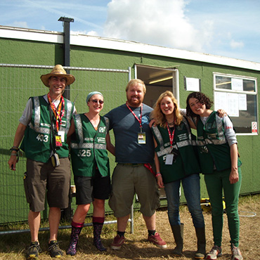 Volunteer at Reading Festival - Arena volunteers with supervisor by office