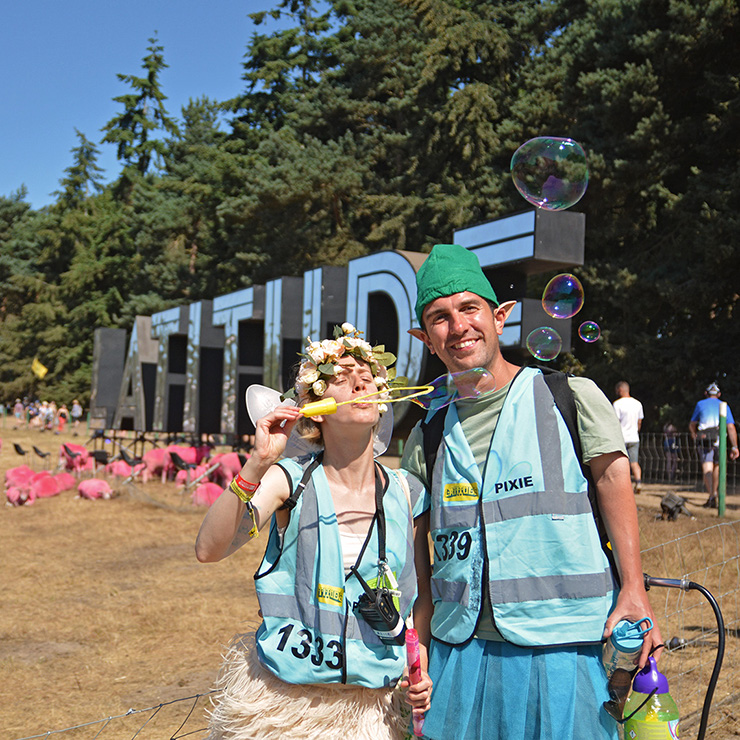 Volunteer at Latitude Festival with Hotbox Events - Arena volunteers by latitude sign