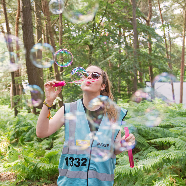Volunteer at Latitude Festival with Hotbox Events - Pixie volunteer with bubbles