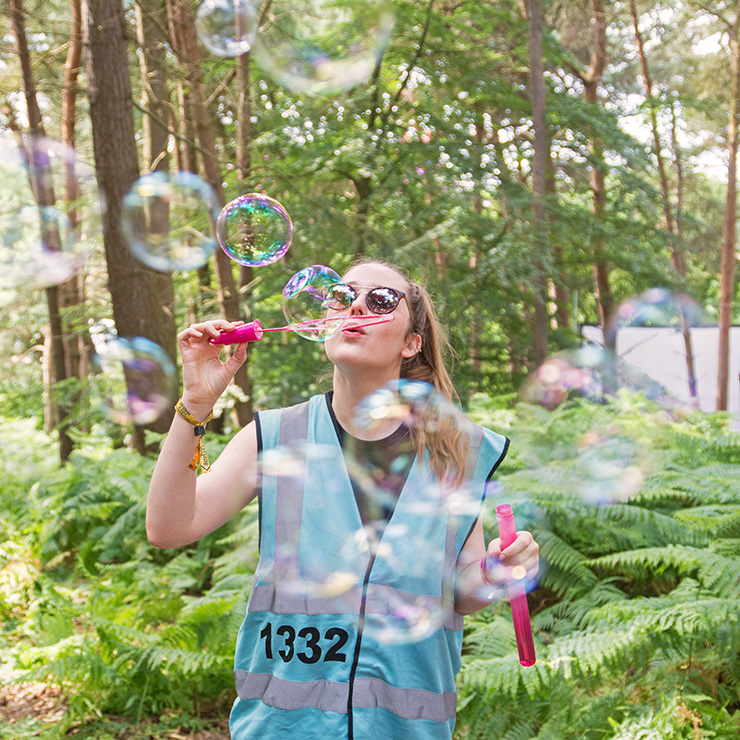 Volunteer at Camp Bestival with Hotbox Events - Right column - Volunteer blowing bubbles