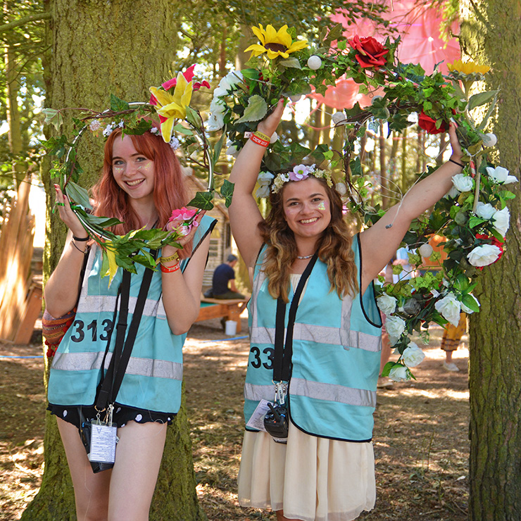 Volunteer at Camp Bestival with Hotbox Events - Right column - Volunteers holding flowers
