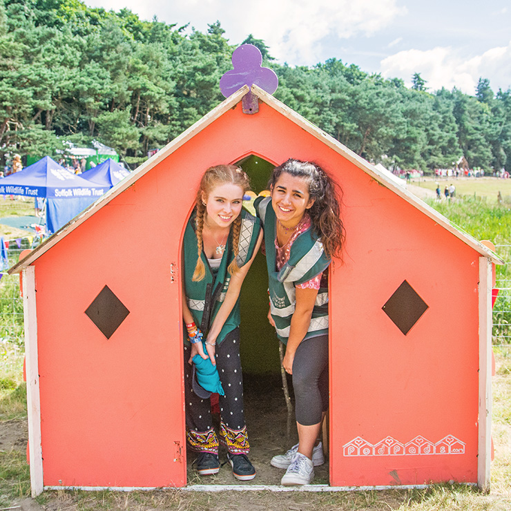 Volunteer at Camp Bestival with Hotbox Events - Right column - Kids area volunteers in little house