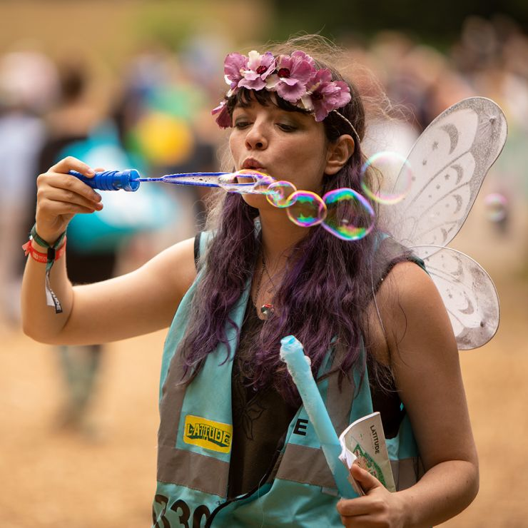 Volunteer at Latitude Festival 2020 with Hotbox Events - Pixie volunteer with wings blowing bubbles