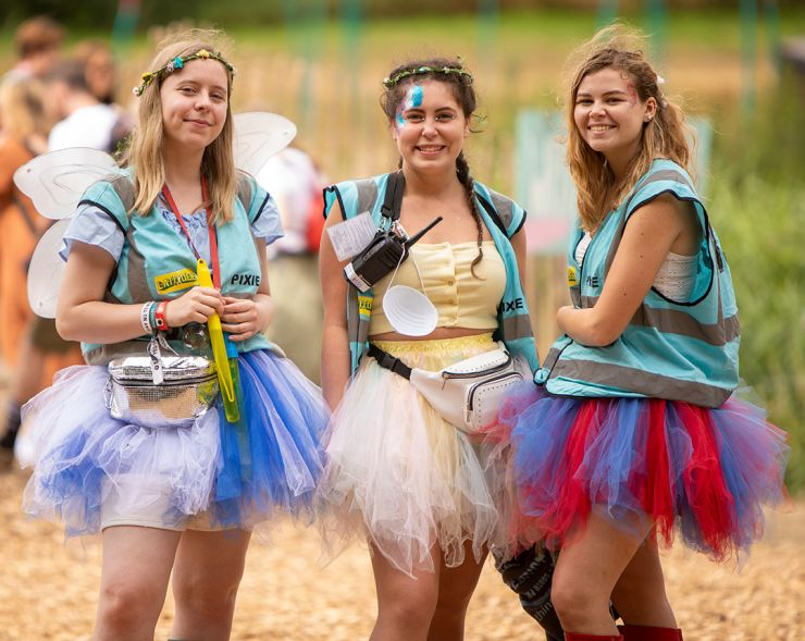Volunteer at Latitude Festival 2020 with Hotbox Events - Pixie volunteers wearing wings by the lake