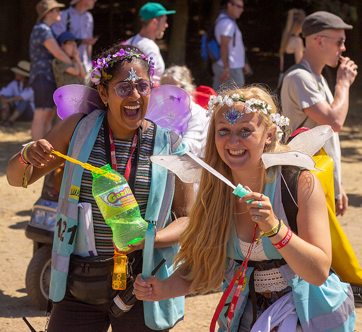 Volunteer at Latitude Festival 2020 with Hotbox Events - Pixie volunteers laughing and blowing bubbles