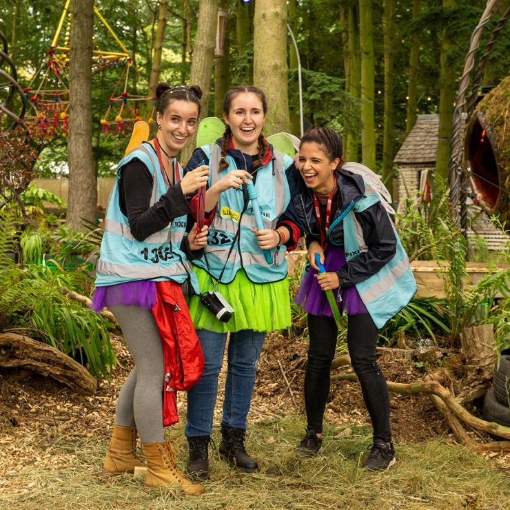 Volunteer at Latitude Festival 2020 with Hotbox Events - Pixie volunteers laughing in the woods