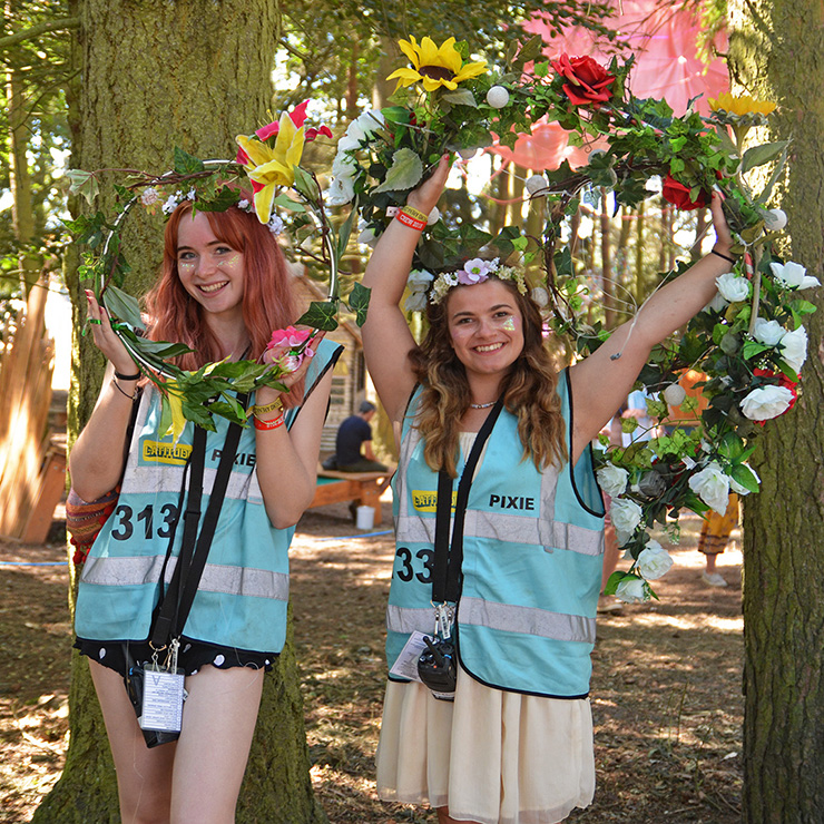 Volunteer at Latitude Festival 2020 with Hotbox Events - Pixie volunteers in the woods with flower garlands